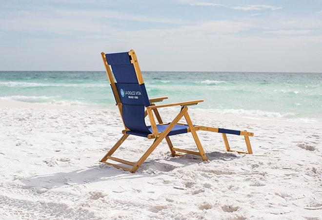 Beach chairs on beach sand.